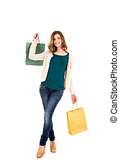 Beautiful woman holding shopping bags over white backgroung