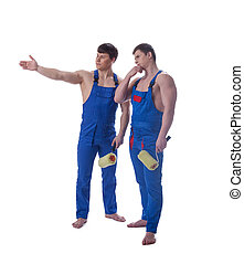 Two handsome painters in blue overalls