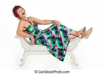 Feet up with laughter. - A red head are getting photographed...