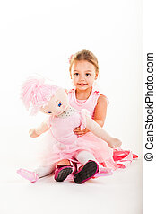 Taking a break with her doll Anabelle. - A little girl...