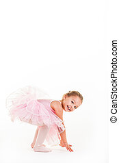 Frog - A little pink ballerina in a playful mood in the...