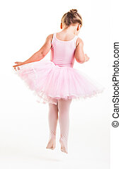 Jumps - A little pink ballerina in a playful mood in the...