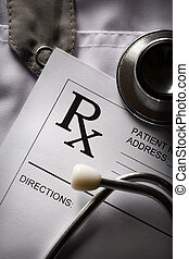 Stethoscope and patient list on doctors smock