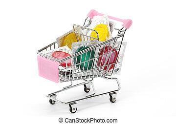 Colored condoms in shoping cart over white