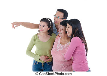 happy adult asian family pointing somewhere