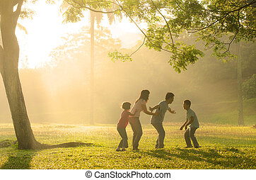 chinese family having quality time playing at outdoor park