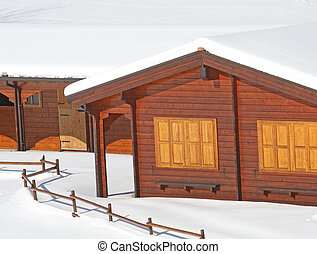 wooden mountain chalet in the Alps in Italy after a snowfall...
