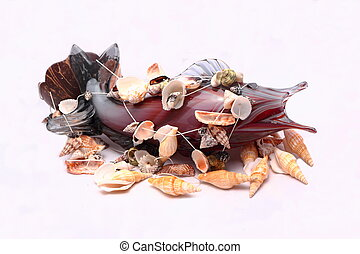 Glass fish tangled in shells.