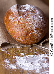 baked homemade bread - Freshly baked homemade bread dusted...