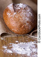 baked homemade bread - Freshly baked homemade bread dusted...