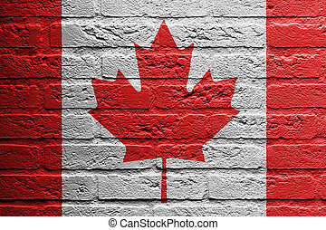 Brick wall with a painting of a flag isolated, Canada