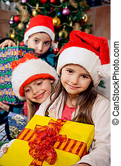 Christmas morning - Christmas morning. Happy kids in pajamas...