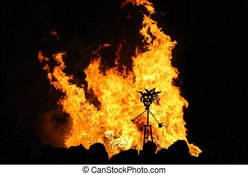Guy Fawkes celebration - Man burning in bonfire during a Guy...