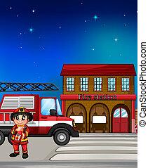 A fireman near the fire station