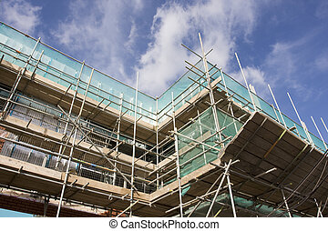 scaffolding - tall building scaffolding against a blue sky