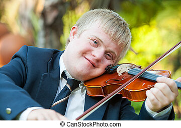 Portrait of young handicapped violinist. - Portrait of young...
