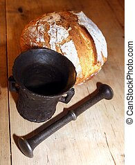Bread and mortar - Old iron mortar in front of newly baked...