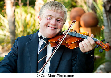Smiling handicapped boy playing his violin. - Close up...