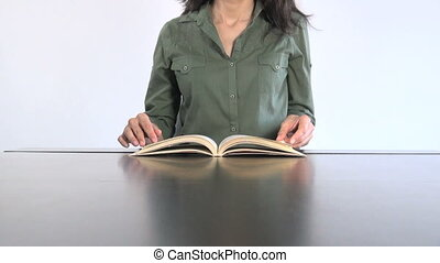 green shirt woman reading book 30