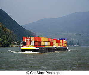 Cargo ship with containers on Rhine river
