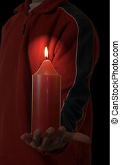 Eternal Hope - Someone holding out a burning candle in the...