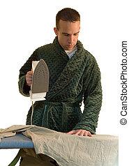 Man Ironing - A man ironing his shirt for work