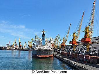 Bulk cargo ship, train and crane - Bulk cargo ship and train...