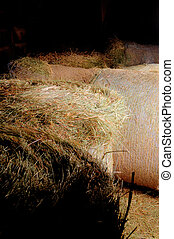 Hay - Golden straw in a barn stacked on the farm