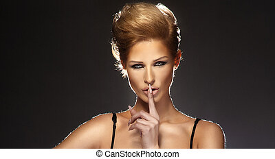 Young Woman Gesturing for Quiet or Shushing - Young...