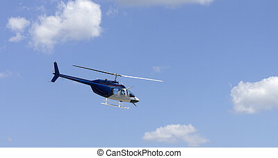 helicopter over blue sky - image of an helicopter fying over...