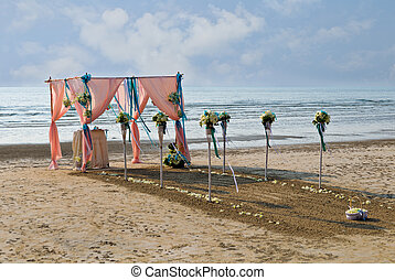 Flower decoration at the beach wedding venue.
