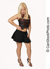 Standing woman in black mini skirt - A young pretty woman...