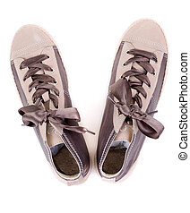 pair of fashionable sneakers on a white background. View from above.