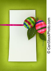 Easter card on green background with multi colored eggs