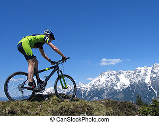 Mountain biker riding through the mountains in the European...