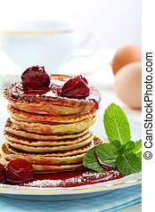 Small pancakes with fruit sauce - Pancakes with cherry sauce...