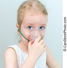 Portrait of little girl with inhalator mask on the face