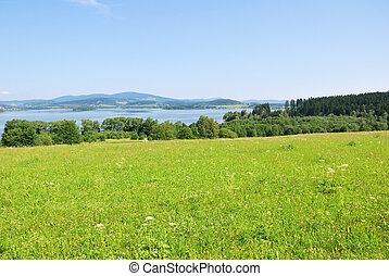 Lipno dam reservoir and green hillside country