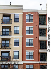 Brown and Yellow Condos with Balconies - Brown and yellow...