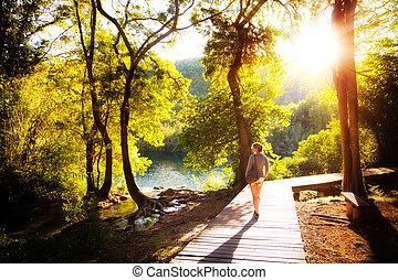 Krka sunset forest walk - Beautiful young woman walks in...