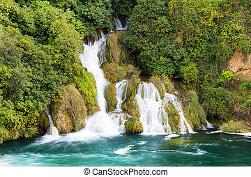 Krka forest waterfall - Beautiful scenic view of a stream of...