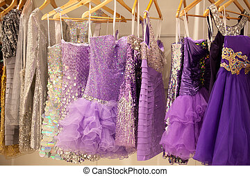 Glitter dresses in a closetstore