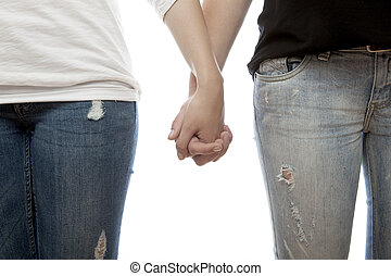 young beautiful girls holding hands - young beautiful red...