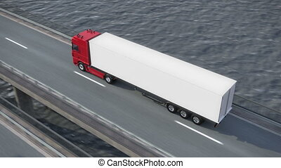 Truck on bridge from above - Truck driving along a bridge -...