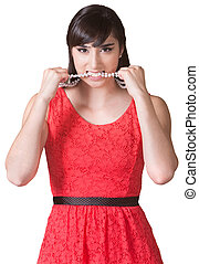 Angry Lady Biting Necklace - Angry young woman biting her...