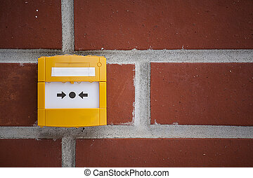 air ventilation emergency stop button at a brick wall