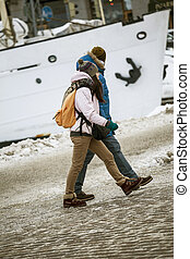 two people walking at the same pace - two people walking at...