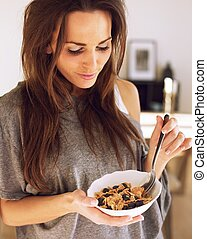 Woman with a Bowl of Cereal