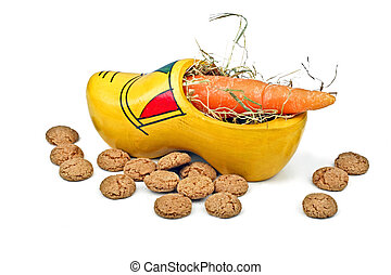 Wooden clog with straw, gingernuts and carrot for 5 december...