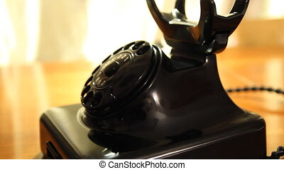 Vintage black telephone. Man dials